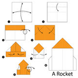 Step by step instructions how to make origami A Rocket. Royalty Free Stock Photo