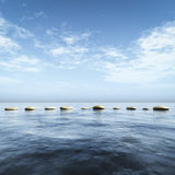 Step stones in the blue sea Royalty Free Stock Photography