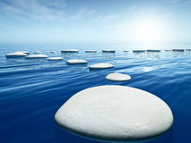 Step stones in the blue sea Royalty Free Stock Image