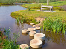 Step stones. Stepping Stones in Water of a Pond Stock Photo