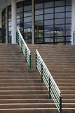 Step to auditorium. Step, green handrail and auditorium royalty free stock photography