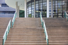 Step to auditorium. Step, green handrail and auditorium stock photos