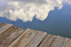 A step to the sky below. Reflection of sky and cloud on water Royalty Free Stock Photo