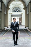Step to success. Young businessman goes to work. Stock Photo