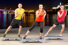 Step training. Active young people on outdoor step training Royalty Free Stock Photography
