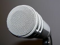 Step up to the mic. A large broadcast or studio microphone stock photography