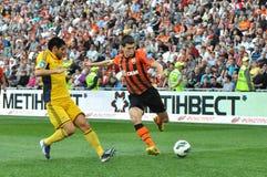 Stepanenko Taras gaat de bal schoppen Stock Foto's