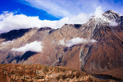 Stepantsminda village in Caucasus mountains near mount Kazbek Royalty Free Stock Photos