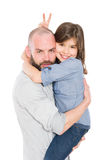 Stepfather father and young daughter. Cool stepfather father holding young daughter in his arms Royalty Free Stock Photos