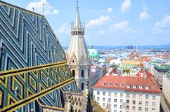 Stephansdom cathedral from its top in Vienna, Austria. Fragment of colorful roof tiles mosaic. Stephansdom cathedral from its top in Vienna, Austria royalty free stock photo