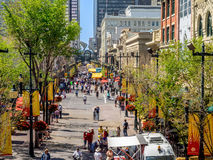 Stephen Avenue during Stampede. CALGARY, CANADA - JULY 13: Busy Stephen Avenue in Calgary during Stampede on July 13, 2014 in Calgary, Alberta Canada. This Stock Photos
