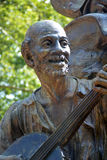 Stephen Foster memorial detail. A statue memorializing the songwriter Stephen Foster in Pittsburgh.   The statue shows a man playing banjo, the main instrument Stock Photo