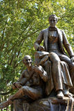 Stephen Foster memorial. A statue memorializing the songwriter Stephen Foster in Pittsburgh.   The statue shows a man playing banjo, the main instrument Foster Stock Photo