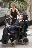 Stephen Hawking. Professor Stephen Hawking and his nurse stock photography