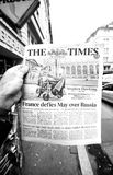 Stephen Hawking on cover of The Times. PARIS, FRANCE - MAR 15, 2018: Hand holding British newspaper The Times with portrait of Stephen Hawking the English Royalty Free Stock Image