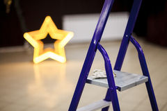 Stepladder closeup, decorating banquet hall of event. Royalty Free Stock Photo