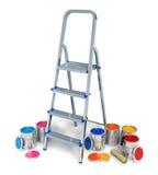 Stepladder con las latas de pintura del color Foto de archivo