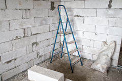 Stepladder in the corner. During capital repair Stock Photo