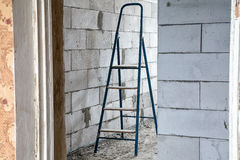 Stepladder in the dirty room Royalty Free Stock Photos