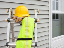 Stepladder. With hardhat, work gloves, and reflective safety vest Royalty Free Stock Images