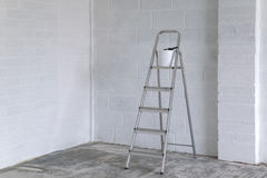 Stepladder and paint pot Royalty Free Stock Photography