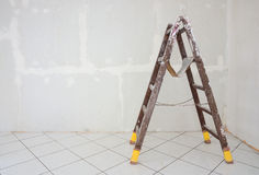 Stepladder standing in the room Stock Images