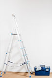 Stepladder and tools for repair Stock Photography
