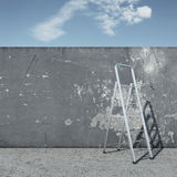 Stepladder with wall in front of sky Royalty Free Stock Photo
