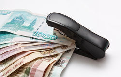 Stepler sujeta el dinero Foto de archivo libre de regalías