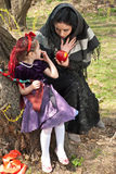 Stepmother gives poisoned apple to snow white Royalty Free Stock Photography