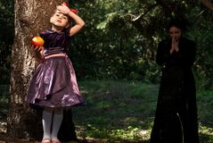 Stepmother gives poisoned apple to snow white Stock Photo