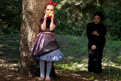 Stepmother gives poisoned apple to snow white Stock Images