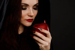 Stepmother witch gives poisoned red apple Royalty Free Stock Photos