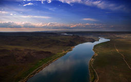 Steppe hang-glider eyes. The river Ili in Asia steppe view from deltaplane, look through hang-glider eyes Royalty Free Stock Images