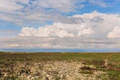 Steppe. Karakol Nature Reserve Kazakhstan, Aktau. Beautiful clouds hang very low over the  steppe Stock Photo