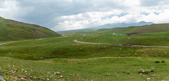 Steppe Kazakhstan, Trans-Ili Alatau, plateau Assy,. A road is in mountains stock image