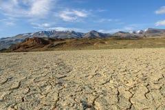 Steppe mountain sky desert cracks Stock Image