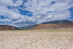 Steppe mountains desert sky Stock Image