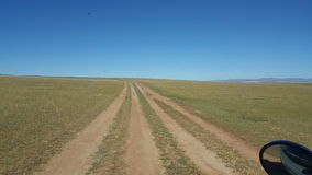 Steppe road mongolia. Steppe road in Mongolian countryside Stock Photos