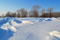 Steppe snowdrifts. Snow white mashed snowdrifts in the forest-steppe of Altai Stock Photos