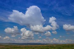 Steppe in spring, Kazakhstan. Amazing clouds and sky Royalty Free Stock Photo