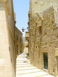 Stepped alley. Paved back street alley with steps leading upwards in gozo, malta Stock Photo