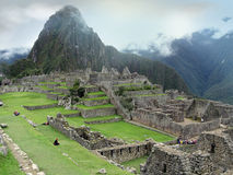 Stepped architecture of Machu Picchu. Peru. Structure architecture of temple complex Machu Picchu: guard houses, agriculture terraces and surrounding mountains Stock Image