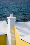 Stepped Bermudian roofs. Bermudian roofs against a dark sea royalty free stock image
