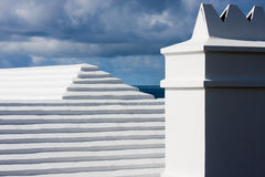 Stepped Bermudian roofs. Bermudian roofs against a cloudy blue sky royalty free stock image