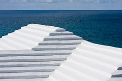 Stepped Bermudian roofs. Bermudian roofs against a dark sea royalty free stock images