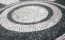 Stepped on Circles. Portuguese sidewalk with drawings in circles Royalty Free Stock Photo