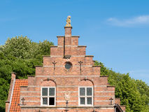 Stepped gable of old town hall in Woudrichem, Netherlands. Stepped gable of old town hall in Hoogstraat in fortified city of Woudrichem, Brabant, Netherlands stock photo
