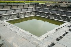 Stepped Pond. Historical pond with steps of dressed stone at Hampi (Vijayanagar), Karnataka, India, Asia Stock Image