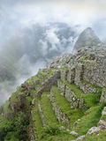 Stepped terraces of Machu Picchu in Peru. Ancient architecture with agriculture terraces of Machu Picchu in Peru. inca empire world wonder Royalty Free Stock Images